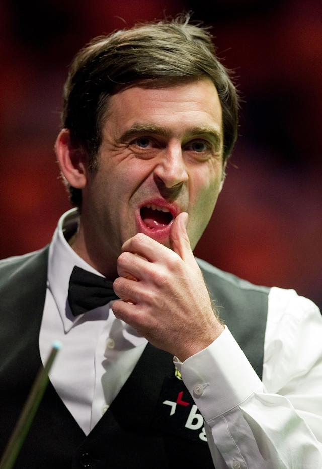 Ronnie O'Sullivan of England reacts after playing a shot against Ding Junhui of China during the first round match in the BGC Masters snooker tournament at Alexandra Palace in north London on January 15, 2012. AFP PHOTO / LEON NEAL (Photo credit should read LEON NEAL/AFP/Getty Images)