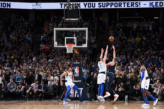 Nikola Jokić makes the game-winning shot against the Dallas Mavericks, sealing the Nuggets' comeback from a 12-point deficit. (Photo by Garrett Ellwood/NBAE via Getty Images)
