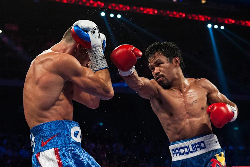 "Manny Pacquiao (R), who says a much-anticipated fight with unbeaten Floyd Mayweather is ""near"", fightst Chris Algieri in Macau in November 2014 (AFP Photo/Xaume Olleros)"
