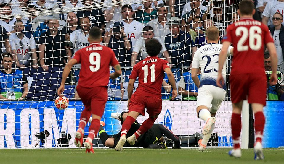 Liverpool's Mohamed Salah scores his side's first goal of the game. (Photo by Peter Byrne/PA Images via Getty Images)