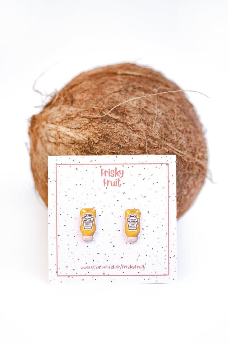 """<p><strong>FriskyFruit</strong></p><p>etsy.com</p><p><strong>$13.90</strong></p><p><a href=""""https://go.redirectingat.com?id=74968X1596630&url=https%3A%2F%2Fwww.etsy.com%2Flisting%2F851291985%2Fheinz-mustard-earrings-heinz-mustard&sref=https%3A%2F%2Fwww.womenshealthmag.com%2Flife%2Fg33844080%2Fgag-gifts%2F"""" rel=""""nofollow noopener"""" target=""""_blank"""" data-ylk=""""slk:Shop Now"""" class=""""link rapid-noclick-resp"""">Shop Now</a></p><p>Mustard, anyone? These mini earrings are just plain funny. Give them to the condiment-lover in your life and they'll def laugh (and thank you). </p>"""