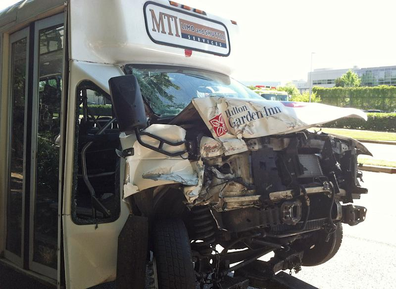 A wrecked airport shuttle bus is shown Friday, May 24, 2013 in College Park, Ga.. The bus collided with a truck near Hartsfield Jackson Atlanta International Airport injuring 16 people who were taken to area hospitals. (AP Photo/Ray Henry)