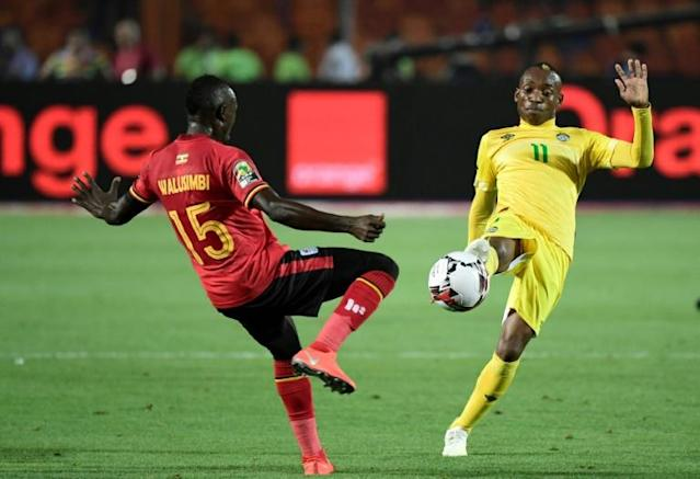 A file photo of star Zimbabwe forward Khama Billiat (R) playing against Uganda during the 2019 Africa Cup of Nations in Egypt (AFP Photo/JAVIER SORIANO)