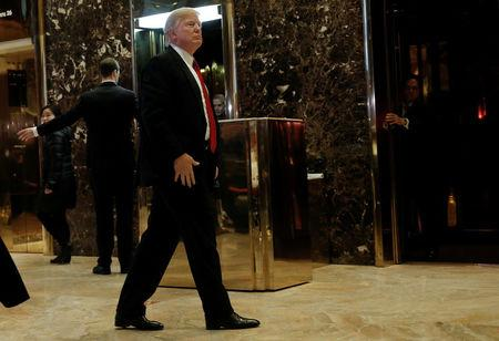 U.S.President-elect Donald Trump makes an appearance in the lobby at Trump Tower in New York, U.S., January 13, 2017. REUTERS/Mike Segar