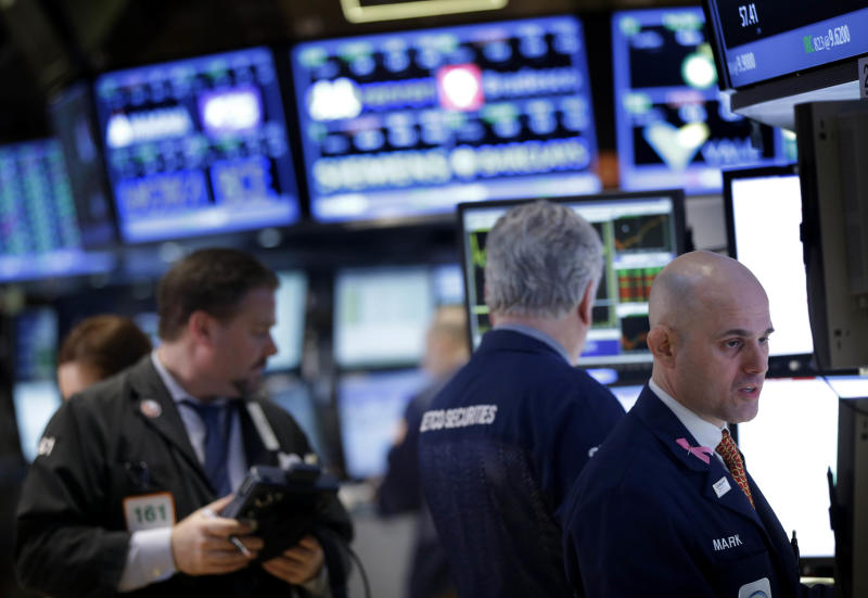 Traders work on the floor at the New York Stock Exchange in New York, Wednesday, Feb. 27, 2013. Stocks surged for a second day, putting the Dow on track for its highest close of the year.  (AP Photo/Seth Wenig)
