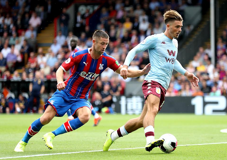 Crystal Palace's Gary Cahill (left) and Aston Villa's Jack Grealish (right) battle for the ball during the Premier League match at Selhurst Park, London.