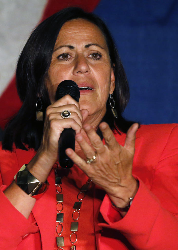Democratic state Sen. Angela Giron greets a crowd of supporters at a rally on the night in which the tally of a close recall vote were still being counted, in Pueblo, Colo., Tuesday Sept. 10, 2013. Campaigns worked to get as many voters as possible to the polls in Colorado's first legislative recalls on Tuesday, elections that tested popular support for gun limits in a state with a strong tradition embracing Second Amendment rights. (AP Photo/Brennan Linsley)