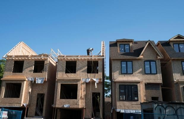 The housing and climate change crises in Canada are interconnected, experts say, and efforts to build more homes must account for an uncertain future.  (Graeme Roy/Canadian Press - image credit)