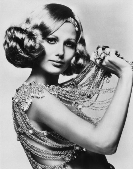 <p>A model channels flappers from the '20s by fastening her curls into a tight bob with a beaded headband. Proof that trends always come back into style. </p>