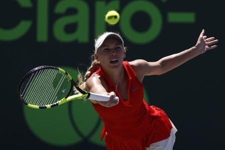 Mar 30, 2017; Miami, FL, USA; Caroline Wozniacki of Denmark hits a forehand against Karoilina Pliskova of the Czech Republic (not pictured) in a women's singles semi-final during the 2017 Miami Open at Crandon Park Tennis Center. Geoff Burke-USA TODAY Sports