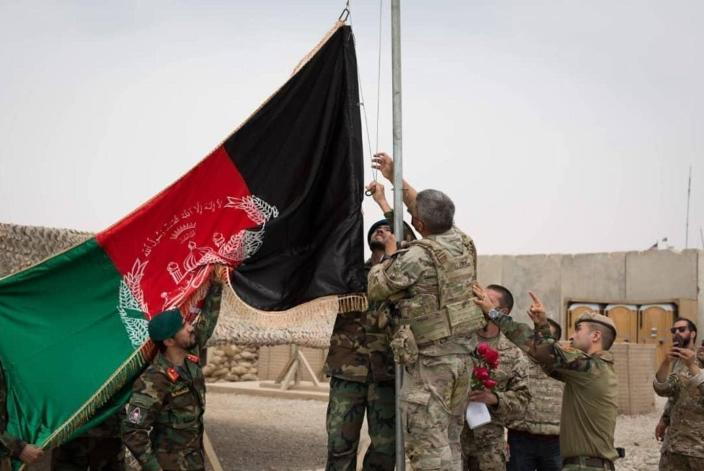 """<span class=""""caption"""">In May, Afghan troops raised their national flag as the U.S. pulled out. Now, their flag is down too.</span> <span class=""""attribution""""><a class=""""link rapid-noclick-resp"""" href=""""https://newsroom.ap.org/detail/AfghanistanTimeLine/427de00c8eb7482da3df9fa0015bcd47/photo"""" rel=""""nofollow noopener"""" target=""""_blank"""" data-ylk=""""slk:Afghan Ministry of Defense Press Office via AP"""">Afghan Ministry of Defense Press Office via AP</a></span>"""
