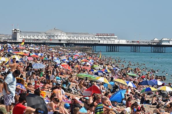 Beachgoers pack the beach in Brighton, on the south coast of England.