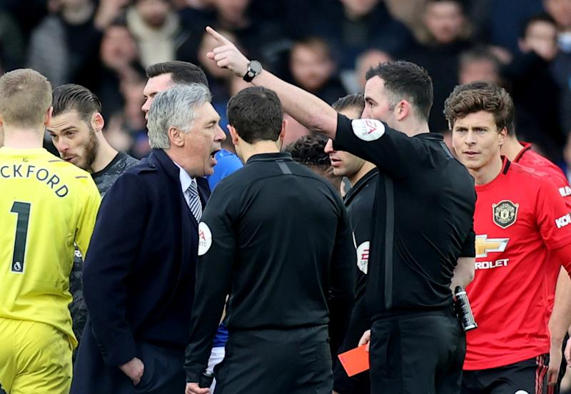 """Soccer Football - Premier League - Everton v Manchester United - Goodison Park, Liverpool, Britain - March 1, 2020 Everton manager Carlo Ancelotti is shown a red card by referee Chris Kavanagh after the match Action Images via Reuters/Carl Recine EDITORIAL USE ONLY. No use with unauthorized audio, video, data, fixture lists, club/league logos or """"live"""" services. Online in-match use limited to 75 images, no video emulation. No use in betting, games or single club/league/player publications. Please contact your account representative for further details."""