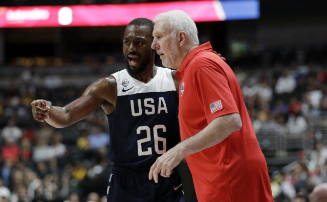 United States' Kemba Walker, left, talks to coach Gregg Popovich during the first half of the team's exhibition basketball game against Spain on Friday, Aug. 16, 2019, in Anaheim, Calif. (AP Photo/Marcio Jose Sanchez)