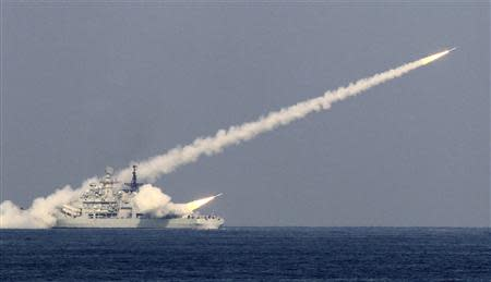 Guided missiles are launched during a drill of the North Sea Fleet in Qingdao, Shandong province, in this October 17, 2013 file photo. REUTERS/Stringer/Files