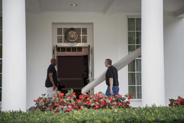<p>Workmen carry carpet into the West Wing of the White House in Washington, Friday, Aug. 11, 2017, during renovations while President Donald Trump is spending time at his golf resort in New Jersey. (AP Photo/J. Scott Applewhite) </p>