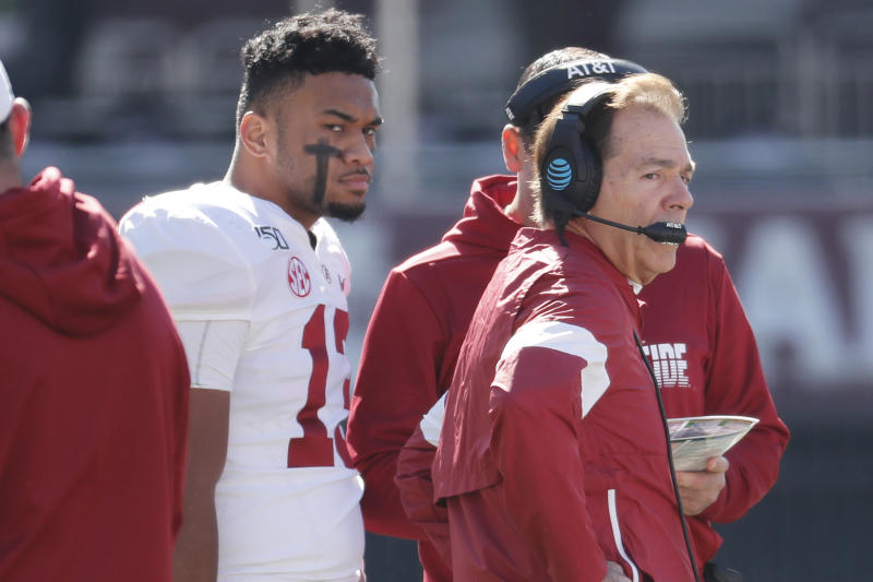Alabama quarterback Tua Tagovailoa (13) listens to instructions from head coach Nick Saban during a timeout in the first half of an NCAA college football game against Mississippi State in Starkville, Miss., Saturday, Nov. 16, 2019. (AP Photo/Rogelio V. Solis)