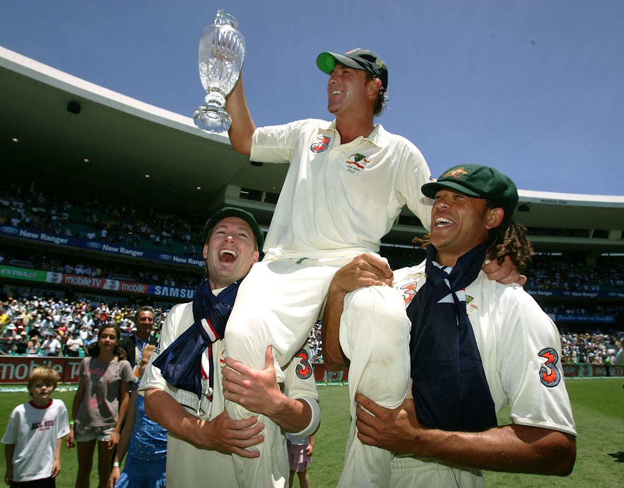 SYDNEY, AUSTRALIA - JANUARY 05:  Shane Warne of Australia celebrates on the shoulders of Michael Clarke (L) and Andrew Symonds with the Ashes trophy after winning the final test and wrapping up the series 5-0 on day four of the fifth Ashes Test Match between Australia and England at the Sydney Cricket Ground on January 5, 2007 in Sydney, Australia.  (Photo by Hamish Blair/Getty Images)