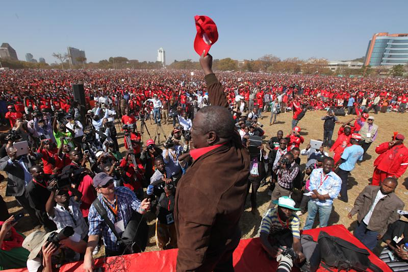 Zimbabwean Movement For Democratic Change (MDC) President Morgan Tsvangirai addresses thousands of party supporters at his last campaign rally before elections set for July 31, in Harare Monday, July, 29, 2013. Tsvangirai said he was confident of victory against his main opponent President Robert Mugabe (AP Photo/Tsvangirayi Mukwazhi)