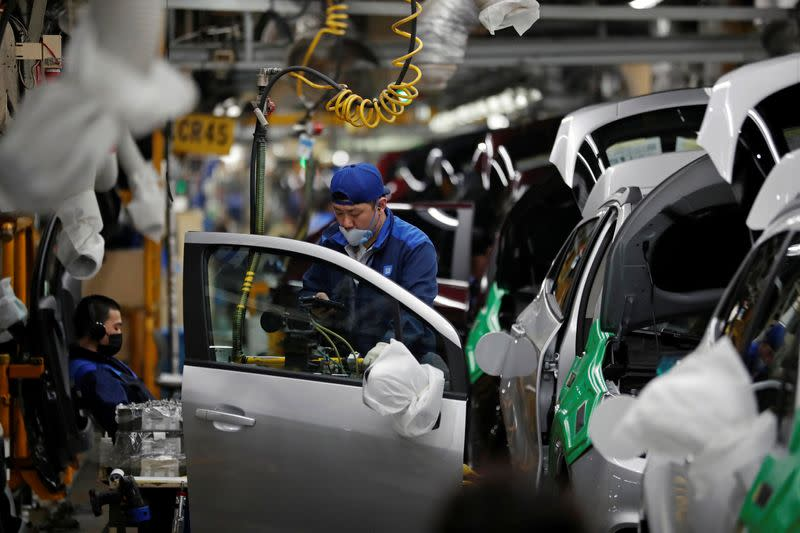 An employee works at an assembly line of GM Korea's Bupyeong plant in Incheon