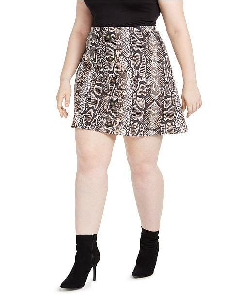 """<p>If we're going out, we want to be wearing this <a href=""""https://www.popsugar.com/buy/Planet-Gold-Trendy-Plus-Size-Printed-Skater-Skirt-496870?p_name=Planet%20Gold%20Trendy%20Plus%20Size%20Printed%20Skater%20Skirt&retailer=macys.com&pid=496870&price=39&evar1=fab%3Aus&evar9=46705422&evar98=https%3A%2F%2Fwww.popsugar.com%2Ffashion%2Fphoto-gallery%2F46705422%2Fimage%2F46705499%2FPlanet-Gold-Trendy-Plus-Size-Printed-Skater-Skirt&list1=shopping%2Cfall%20fashion%2Cfall%2Cskirts%2Ccurve%2Cmacys%2Ccurve%20fashion&prop13=mobile&pdata=1"""" rel=""""nofollow"""" data-shoppable-link=""""1"""" target=""""_blank"""" class=""""ga-track"""" data-ga-category=""""Related"""" data-ga-label=""""https://www.macys.com/shop/product/planet-gold-trendy-plus-size-printed-skater-skirt?ID=10079338&amp;CategoryID=34057"""" data-ga-action=""""In-Line Links"""">Planet Gold Trendy Plus Size Printed Skater Skirt</a> ($39).</p>"""