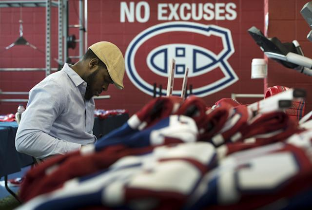 Montreal Canadiens' P.K. Subban signs souvenirs at the team's training facility Saturday, May 31, 2014 in Brossard, Quebec. The Canadiens were eliminated from the NHL hockey Stanley Cup playoffs by the New York Rangers in Game 6 of the Eastern Conference final on Thursday, May 29. (AP Photo/The Canadian Press, Paul Chiasson)