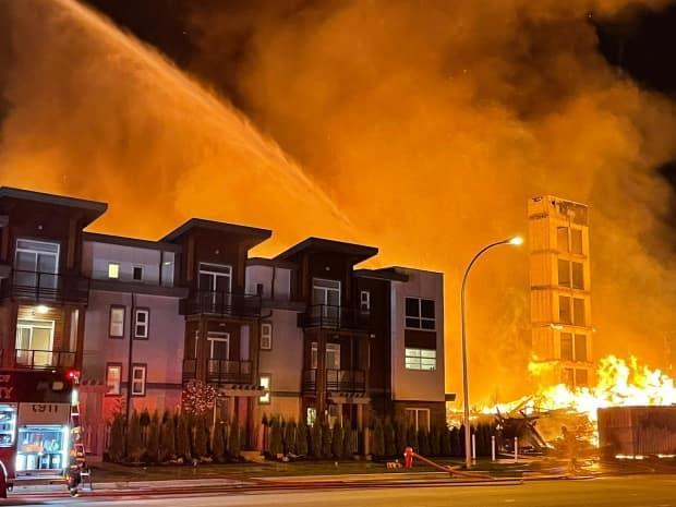 Langley firefighters managed to stop a massive fire from spreading to a fourth building after it engulfed a condo development under construction. (Submitted to CBC News - image credit)