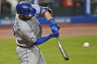Kansas City Royals' Cam Gallagher hits an RBI double during the seventh inning of the team's baseball game against the Cleveland Indians, Tuesday, Sept. 8, 2020, in Cleveland. (AP Photo/Tony Dejak)