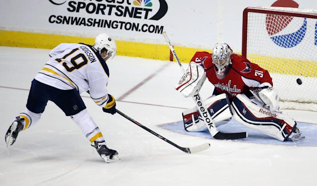 Buffalo Sabres center Cody Hodgson (19) scores the game-winning goal past Washington Capitals goalie Philipp Grubauer (31), from Germany, in the shootout portion of an NHL hockey game, Sunday, Jan. 12, 2014, in Washington. The Sabres won 2-1. (AP Photo/Alex Brandon)