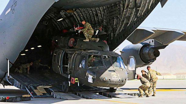 PHOTO: Aerial porters work with maintainers to load a UH-60L Blackhawk helicopter into a C-17 airplane in support of the withdrawl of U.S. troops from Bagram Air Base in Afghanistan, June 16, 2021. (U.S. Military/AFP via Getty Images)