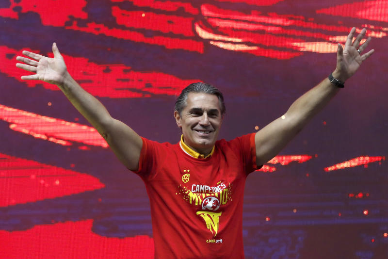Head coach Sergio Scariolo of Spain celebrates with his players from Spain's national basketball team in front of fans in Madrid, Spain, Monday, Sept. 16, 2019. Spain has captured its second World Cup championship, defeating Argentina 95-75 on Sunday. (AP Photo/Bernat Armangue)