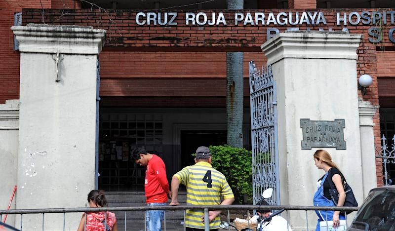 People stand at the entrance of the Red Cross Hospital in Asuncion on May 8, 2015 (AFP Photo/Norberto Duarte)