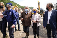 European Commission President Ursula von der Leyen tours the village after flooding in Pepinster, Belgium, Saturday, July 17, 2021. Residents in several provinces were cleaning up after severe flooding in Germany and Belgium turned streams and streets into raging torrents that swept away cars and caused houses to collapse. (AP Photo/Virginia Mayo)