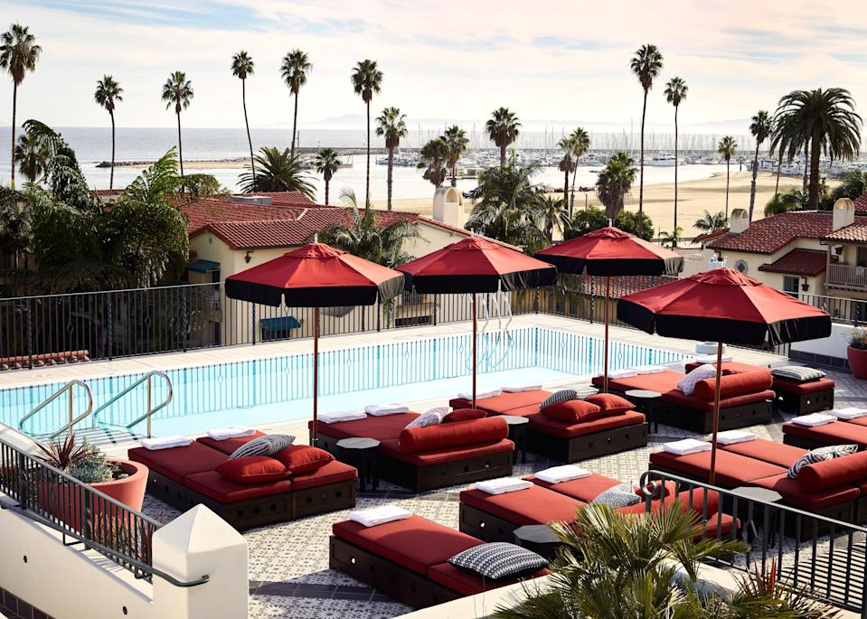 """Named after a tiny Berber village in southern Morocco, the <a href=""""https://www.cntraveler.com/hotels/santa-barbara/hotel-californian?mbid=synd_yahoo_rss"""" rel=""""nofollow noopener"""" target=""""_blank"""" data-ylk=""""slk:Hotel Californian's"""" class=""""link rapid-noclick-resp"""">Hotel Californian's</a> rooftop """"Tan Tan"""" is one of the best spots in Santa Barbara to stretch out poolside with a drink and a snack. Soak up that West Coast sunshine and enjoy wide-open views of the Pacific Ocean and <a href=""""https://www.cntraveler.com/story/how-to-spend-a-weekend-in-californias-santa-ynez-valley?mbid=synd_yahoo_rss"""" rel=""""nofollow noopener"""" target=""""_blank"""" data-ylk=""""slk:Santa Ynez Mountains"""" class=""""link rapid-noclick-resp"""">Santa Ynez Mountains</a>. It's hard to think of a rooftop pool that feels more quintessentially California."""