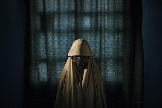 <p>Boko Haram strapped suicide bombs to them. Somehow these teenage girls survived: Aisha, aged 14, Sept. 21, 2017.<br>Portraits of girls kidnapped by Boko Haram militants, taken in Maiduguri, Borno State, Nigeria. The girls were strapped with explosives, and ordered to blow themselves up in crowded areas, but managed to escape and find help instead of detonating the bombs. Boko Haram—a Nigeria-based militant Islamist group whose name translates roughly to 'Western education is forbidden'—expressly targets schools and has abducted more than 2,000 women and girls since 2014. Female suicide bombers are seen by the militants as a new weapon of war. In 2016, The New York Times reported at least one in every five suicide bombers deployed by Boko Haram over the previous two years had been a child, usually a girl. The group used 27 children in suicide attacks in the first quarter of 2017, compared to nine during the same period the previous year. (Photo: Adam Ferguson for The New York Times) </p>