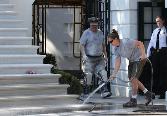 <p>A member of the National Park Service washes the new South Portico steps of the White House on Aug. 22, 2017 in Washington. (Photo: Alex Wong/Getty Images) </p>