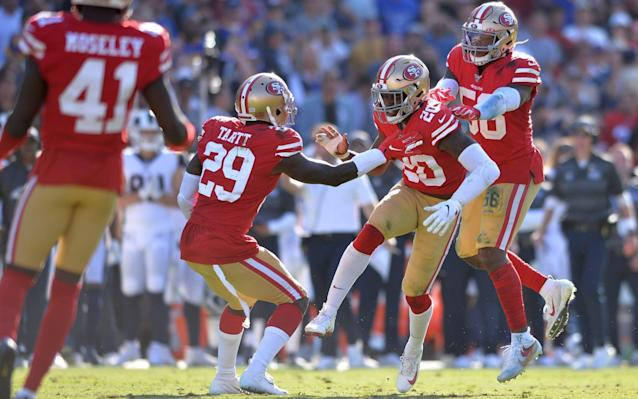 The 49ers defense celebrate getting a stop against the Rams - USA TODAY Sports