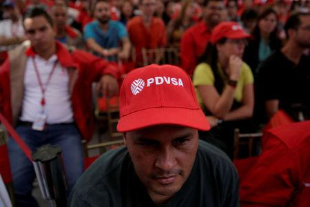 FILE PHOTO: A man wears a cap with the logo of PDVSA as he attends the swear-in ceremony of the new board of directors of Venezuelan state oil company PDVSA in Caracas, Venezuela January 31, 2017. REUTERS/Marco Bello/File Photo