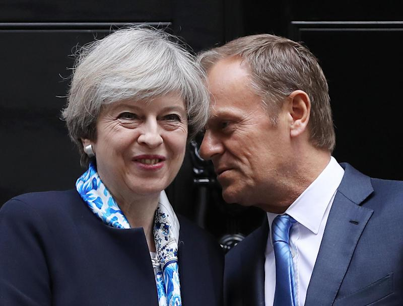 Theresa May and Donald Tusk in somewhat happier times, when they met last month at No 10: Getty