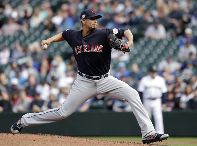 Cleveland Indians starting pitcher Carlos Carrasco throws against the Seattle Mariners during the second inning of a baseball game Wednesday, April 17, 2019, in Seattle. (AP Photo/Elaine Thompson)