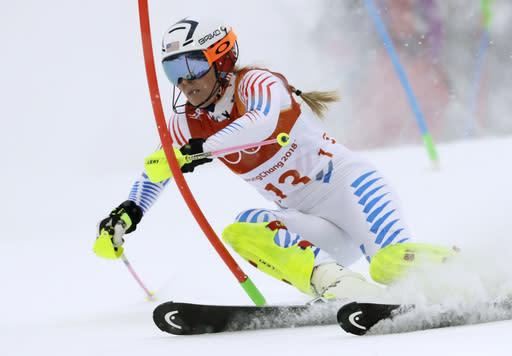 FILE - In this Thursday, Feb. 22, 2018 file photo, Lindsey Vonn competes in the women's combined slalom at the 2018 Winter Olympics in Jeongseon, South Korea. Retirement hasnt slowed down Lindsey Vonn. The all-time winningest female skier in World Cup history has found new adventures like cliff diving with boyfriend and NHL defenseman P.K. Subban, finishing her memoir set to be published next year and serving as an executive producer of a film with Robert Redford. Vonns never been one to sit back and take it easy. (AP Photo/Luca Bruno, File)