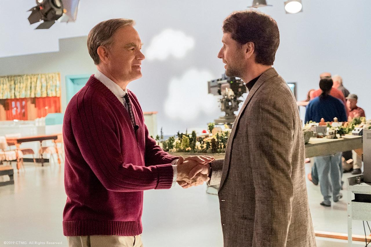 """This heartwarming film depicts the relationship between journalist Lloyd Vogel (Matthew Rhys) and Mister Rogers (Tom Hanks). Vogel is based on <em>Esquire</em> writer Tom Junod, author of the piece <a href=""""https://www.esquire.com/entertainment/tv/a27134/can-you-say-hero-esq1198/"""" target=""""_blank"""">""""Can You Say… Hero?""""</a>which shed light on his life-changing relationship with the beloved children's TV host."""