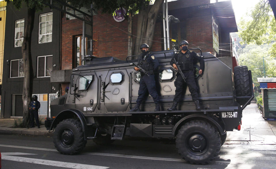 A police vehicle arrives to the place where an abandoned vehicle that is believed to have been used by gunmen in an attack against the chief of police was found, in Mexico City, Friday, June 26, 2020. Heavily armed gunmen attacked and wounded Omar Garcia Harfuch in a brazen operation that left an unspecified number of dead, Mayor Claudia Sheinbaum said Friday. (AP Photo/Marco Ugarte)