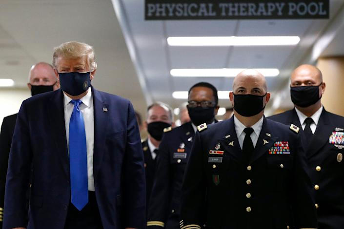 President Donald Trump wears a face mask during a visit to Walter Reed National Military Medical Center in Bethesda, Md., on July 11.