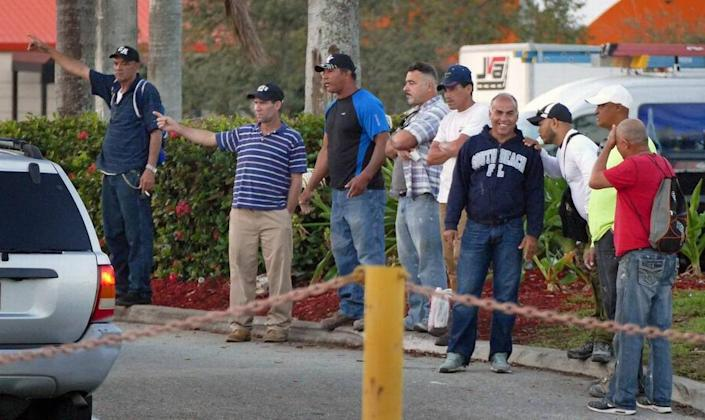 Day laborers try to find work by a Miami-area Home Depot in 2017