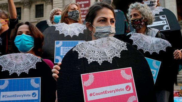 PHOTO: People gather at Fifth Avenue during a 'Count Every Vote' rally in New York on Nov. 4, 2020. (Timothy A. Clary/AFP via Getty Images)