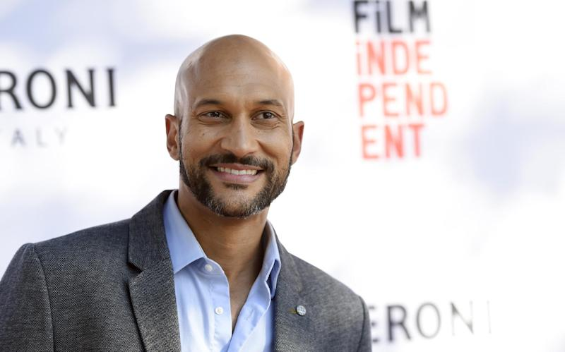 """FILE - In this June 6, 2016 file photo, Keegan-Michael Key, a cast member in """"Don't Think Twice,"""" poses at the premiere of the film during the Los Angeles Film Festival at the ArcLight Culver City in Culver City, Calif.  For nominees, Emmy Day can be a break from calorie counting Summary: Even those Hollywood stars who are most diligent about diet and exercise give in to temptation on special occasions, such as Emmy day.  """"Sunday morning, I'm going to try to eat,"""" said Keegan-Michael Key, a four-time nominee this year, including Outstanding Supporting Actor in a Comedy Series for the sketch show """"Key & Peele."""" (Photo by Chris Pizzello/Invision/AP)"""