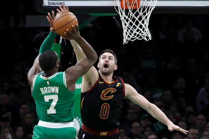 Boston Celtics guard Jaylen Brown (7) shoots against Cleveland Cavaliers forward Kevin Love (0) in the first half of an NBA basketball game, Friday, Dec. 27, 2019, in Boston. (AP Photo/Elise Amendola)