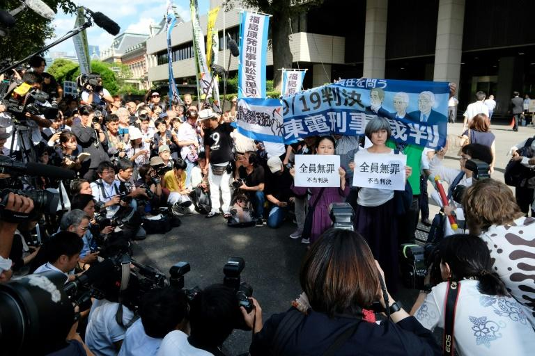Outside the courtroom, dozens of people staged a rally, including some who had travelled from the Fukushima region to hear the verdict (AFP Photo/Kazuhiro NOGI)