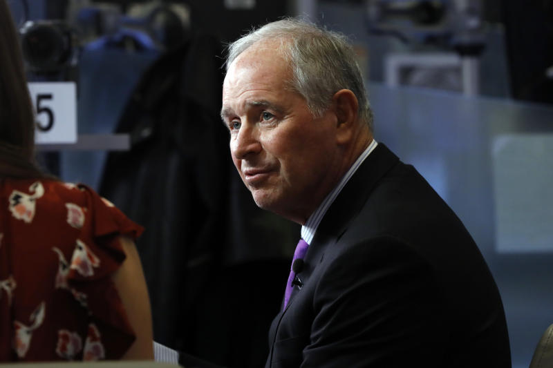 Stephen Schwarzman, chairman, CEO and co-founder of the investment firm Blackstone, is interviewed on the floor of the New York Stock Exchange, Tuesday, Oct. 8, 2019. (AP Photo/Richard Drew)
